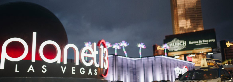 Planet 13 Las Vegas, Nevada exterior of building at night.