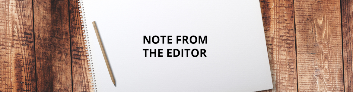 Note From The Editor feature image showing a pad of paper on a wood table with NOTE FROM THE EDITOR on it.